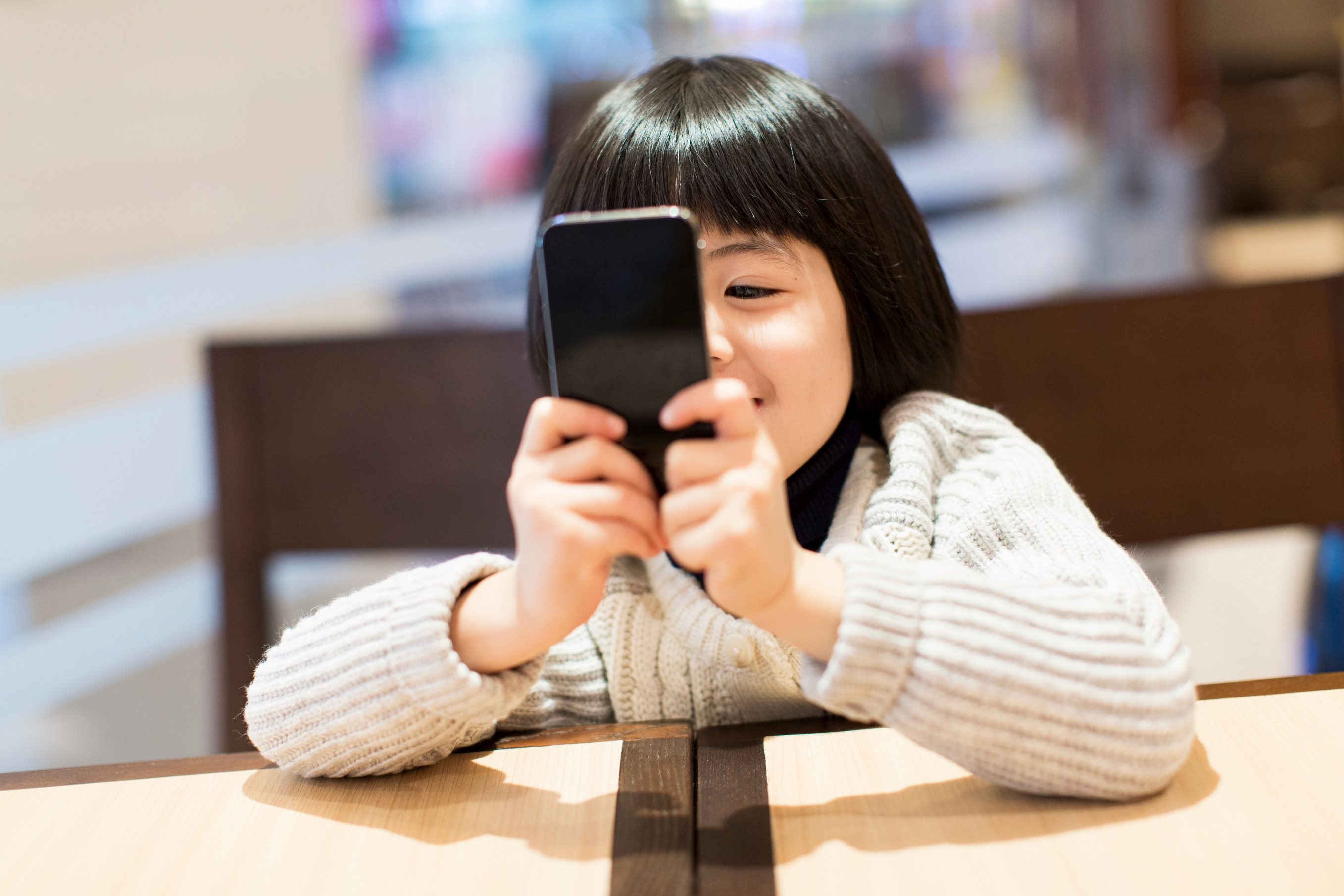 girl with smartphone. Digital Detox: Is your child turning into a digital addict?